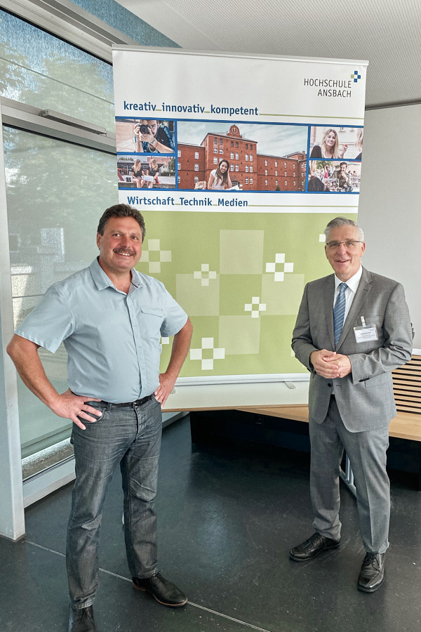 Peter Stadthalter, CEO of PS-HyTech, in conversation with a professor at Ansbach University